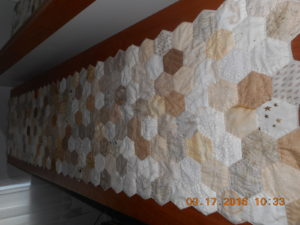 A neutral runner, hand pieced, hand quilted, and appliqued to wool. epp-runner