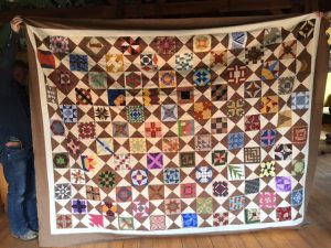 Here is the picture- the Bible Quilt that is English pieced. Three of us worked on it. I did a few b