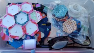 This is my current hexagon project– and in the travel container. It's plastic with a lid