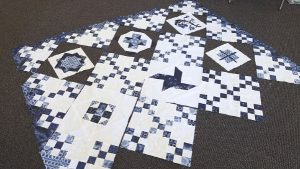 I've been working on some of the other blocks- so far, the quilt top looks like this. I'