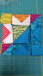 Working on my mini quilt- solar eclipse. Laying the blocks out. 15476719601377027851537654360525