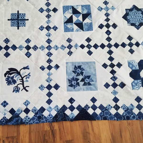 Finished! It's all put together. I need to get it quilted. Not sure what the quilting will be.