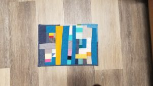 I finished up a mini quilt for a swap I was involved in. I used leftover pieces from the Gee Bend qu