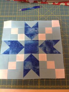Here's mine. This was a fun block to pick fabric for.Good Cheer May