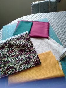 Hi not really sure what to pick but these are my fabrics to start the mystery and I have lots of scr